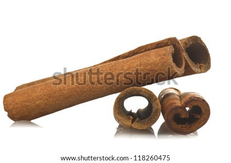 cinnamon sticks stacked on the white background
