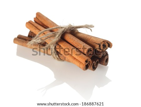 cinnamon sticks tied with rope on white background isolate - stock photo