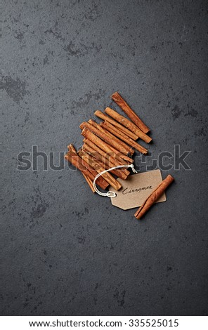 Cinnamon sticks with a paper label - stock photo