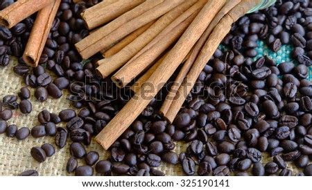 Cinnamon Sticks with coffee beans with selective focus.