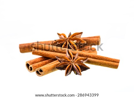 Cinnamon sticks with star anise on white background
