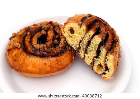 Cinnamon Sticky buns on a plate isolated on a white background