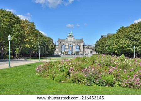 Cinquantenaire Parc in Brussels on blue sky with clouds. This complex commemorates 50 th anniversary of Belgian independence