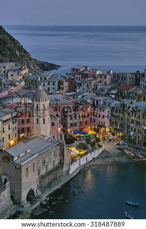 CINQUE TERRE, ITALY - AUGUST 28, 2015: Early evening and the lights come on in the village of Vernazza in the Cinque Terre. Once fishing, now tourism is the main industry.