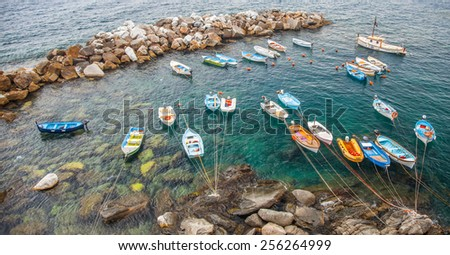 CINQUE TERRE, LIGURIA, ITALY - CIRCA AUGUST 2012. Small boats at  harbor at the popular tourists summer destination in the 5 fishing villages of Cinque Terre, Liguria, Italy.