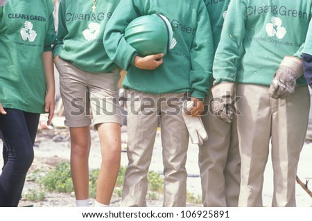 CIRCA 1990 - A close-up of clean and green volunteers and their sweatshirts on Earth Day - stock photo
