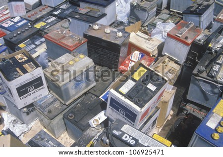 CIRCA 1990 - A pile of car batteries ready for disposal - stock photo