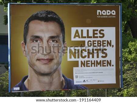 "CIRCA APRIL 2014 - BERLIN: a poster as an advertisement for the non governmental organization ""Nada"" with a portrait of the boxing champo�´�´ion Wladimir Klitschko, Berlin. - stock photo"