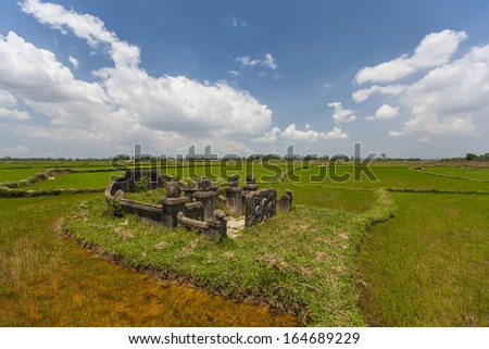 CIRCA APRIL 2010 - QUY NHON, VIETNAM - An ancient family tomb amongst rice fields, on 25 April 2010, in Quy Nhon, Vietnam.