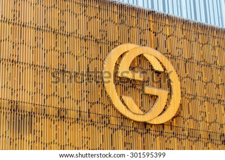 """CIRCA JULY 2015 - HONG KONG: the logo of the brand """"Gucci"""", Hong Kong."""