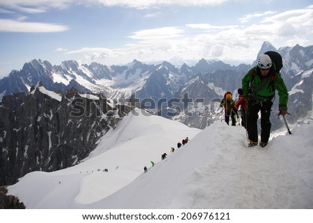 CIRCA JULY 2012 - MONT BLANC: climbers on tours in the Mont Blanc high mountain range near Auigulle du Midi, France. - stock photo