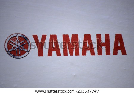 "CIRCA MAY 2014 - BERLIN: the logo of the brand ""Yamaha""."
