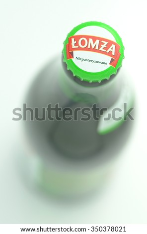 CIRCA NOVEMBER 2015 - GDANSK: Lomza unpasteurized lager beer isolated on white background. Lomza Brewery has been brewing since 1968.