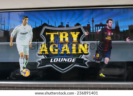 "CIRCA OCTOBER 2014 - BERLIN: the logo of the brand ""Try Again Lounge"" with the portraits of the sport stars Christiano Ronaldo and Lionel Messi, Berlin. - stock photo"
