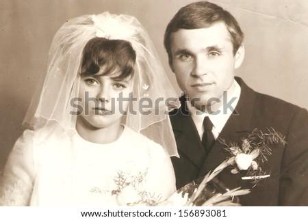 CIRCA 1920: original antique wedding photo. portrait of just married couple. nostalgic picture, circa 1920  - stock photo
