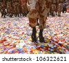 CIRCA 1999 - Soldier walking in confetti after parade - stock photo