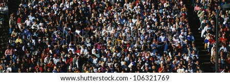 CIRCA 1998 - This is a crowd of people in the stands at the 109th Rose Bowl Parade on New Year's Day. - stock photo
