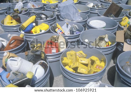 CIRCA 1990 - Various buckets of sorted recyclable materials - stock photo