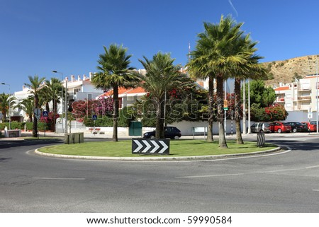 Circle crossroad with palms in Lisbon, Portugal. - stock photo