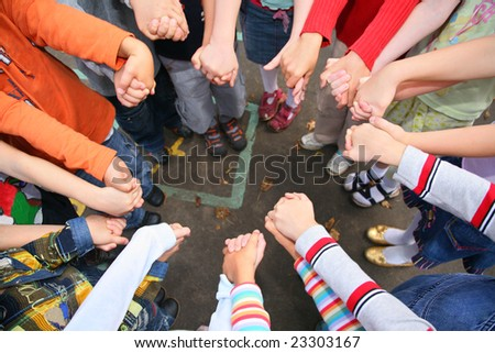 Circle from children, who are held for hands, kindergarten - stock photo