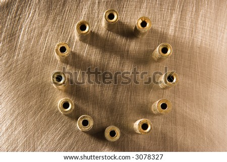 Circle from twelve details on the metal scratched background - stock photo