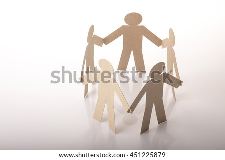 circle joining of five paper figure in hand down posture on white background - stock photo