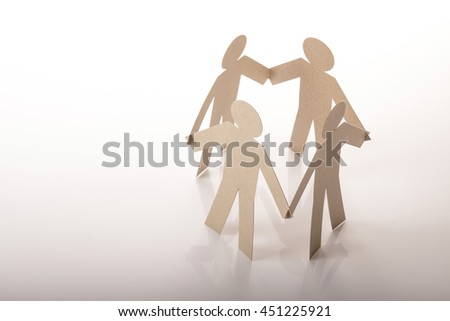 circle joining of four paper figure in hand down posture on white background - stock photo