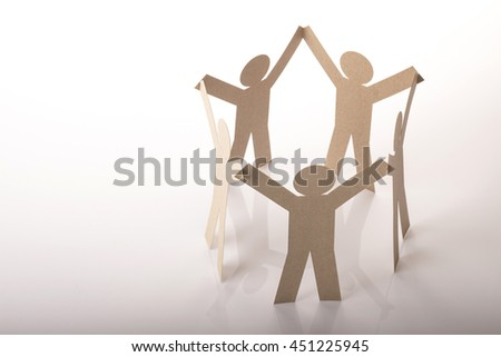 circle link together of five paper figure in hand up posture on white background - stock photo
