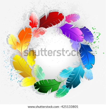 circle of bright rainbow feathers on a light background. Artistic drawing feather. Hand drawing. Bright paint. - stock photo