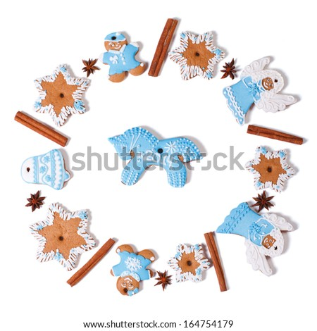 circle of Christmas cookies and a blue horse in the center isolated on white background - stock photo