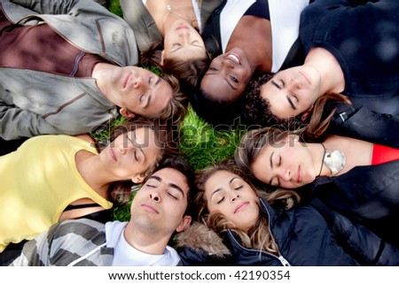 Circle of friends with their heads together on the floor