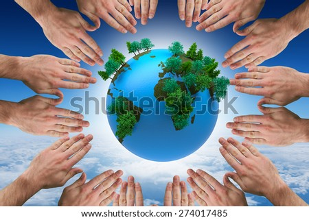 Circle of hands against blue sky over clouds at high altitude