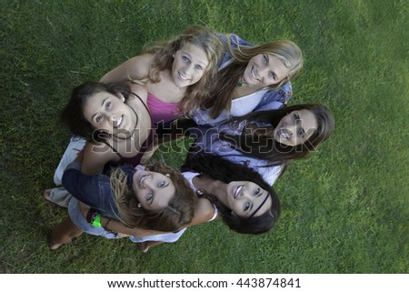 circle of healthy happy smiling  teens looking up