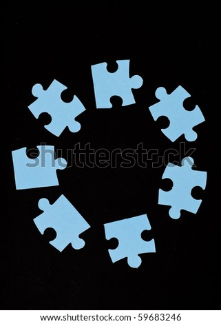 Circle of Puzzle Pieces Background - stock photo