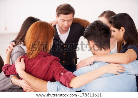 Circle of trust. Group of people sitting in circle and supporting each other
