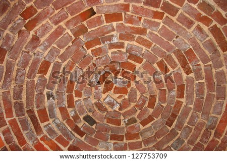 Circle pattern  red brick wall background - stock photo