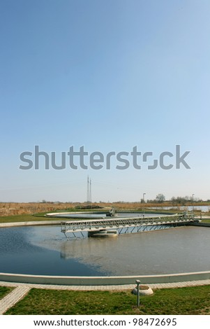 Circle pools for recycling of polluted water in water treatment plant - stock photo