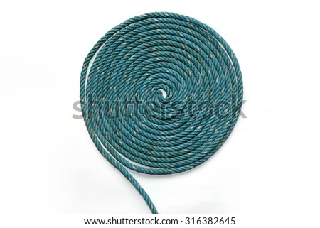 Circle Roll texture of old green nylon rope. - stock photo