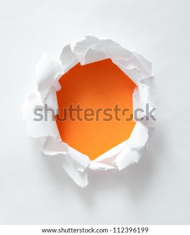 Circle shape breakthrough paper hole with white background.