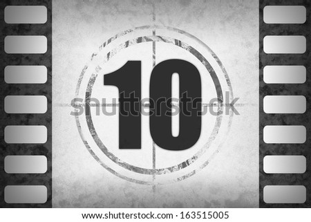 Circled black numbers for movie countdown on white grunge 35mm frame (positive or negative), available as single or full set. - stock photo