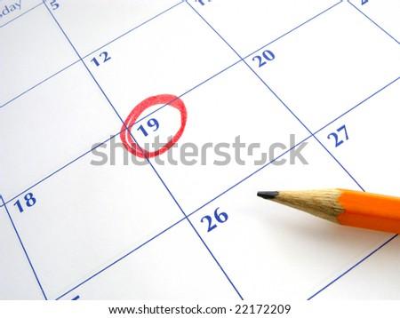 Circled date on a calendar. - stock photo