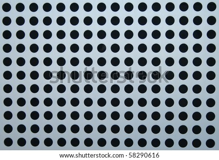 Circles in perforated metal sheet used for cladding building structures
