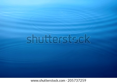 Circles on a water surface - stock photo