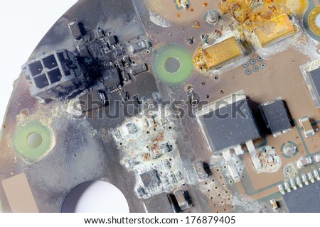 Circuit board after water damage, short circuit - stock photo