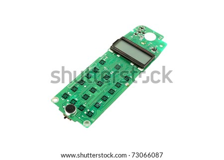 Circuit board (keypad) for cell phone over white.