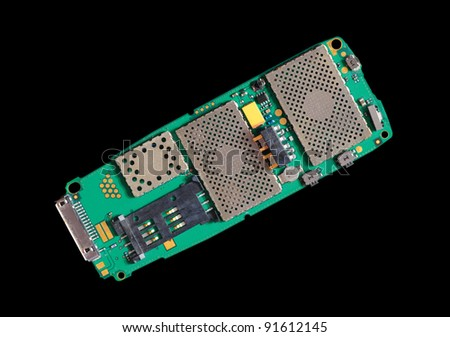Circuit board of a cell phone isolated on black