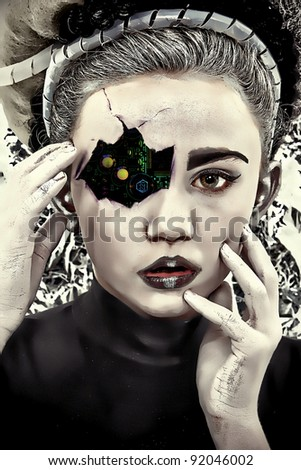 Circuit board showing through cracked and damaged face of cyborg child.  Illustration/photography. - stock photo