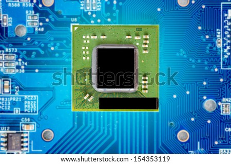 circuit board with micro chip electronic components macro background - stock photo