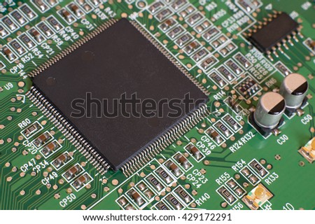 Circuit board with processor and electronic components. Technology concept. - stock photo