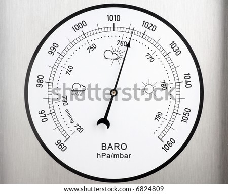 circular barometer, indicating unstable weather - stock photo